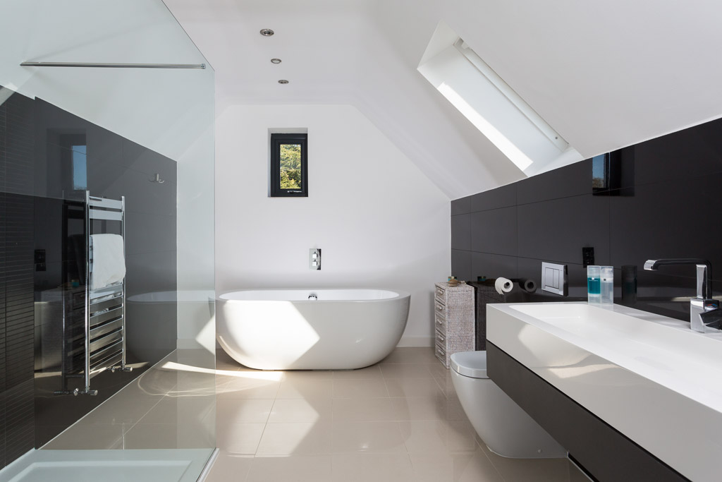 contemporary bathroom with glossy black tiles
