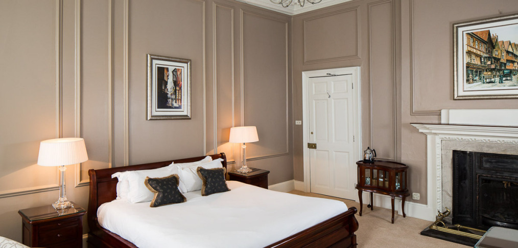 panelled hotel bedroom