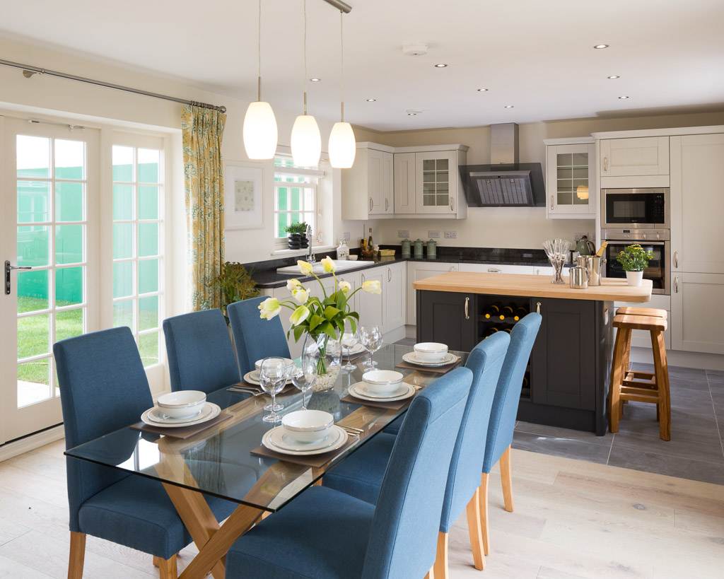 show home painted kitchen with wood worktop island and balck granite in open plan kitchen diner