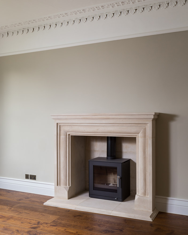 log burner and stone fireplace in period lounge