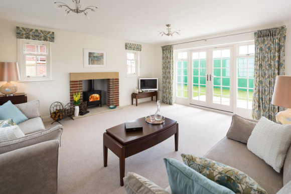 spacious lounge in with log burner