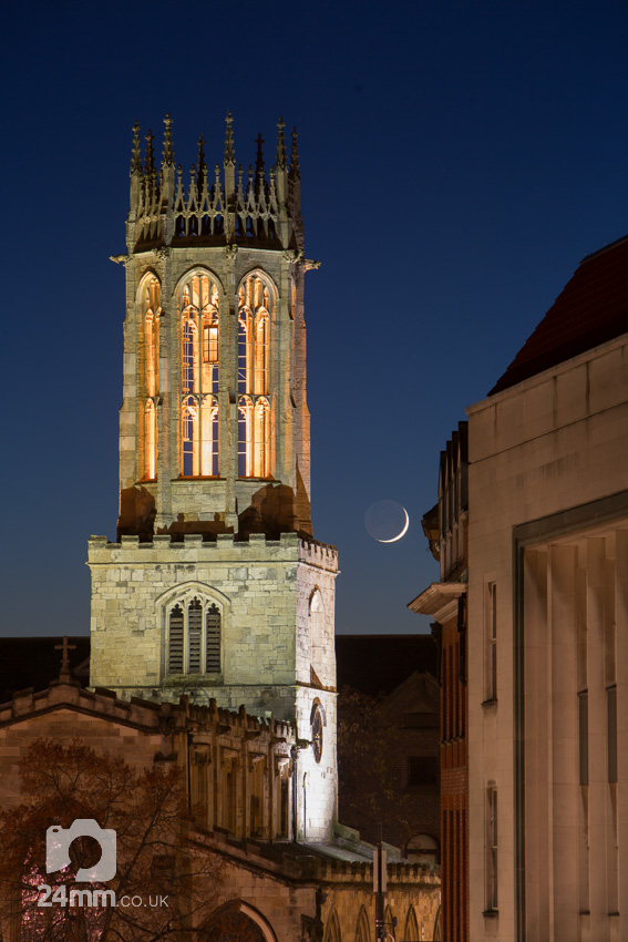 New moon and All Saints Pavement Church bell tower at dusk