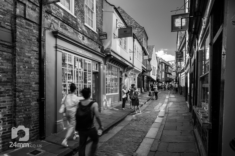 monochrome image of a couple kissing in The Shambles, York