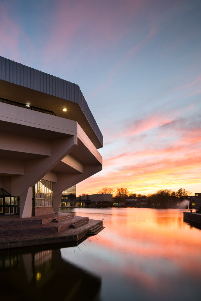 York University Cental Hall and lake at sunset